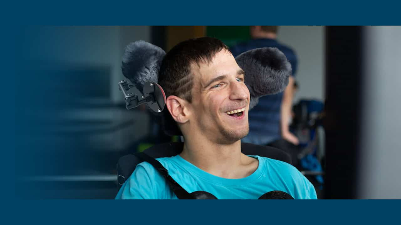 Frank is using Rehadapt's modular mounting system for his wheelchair and AAC device