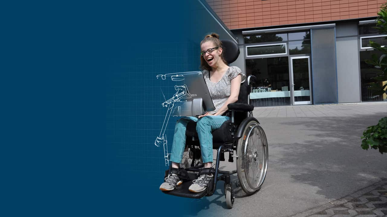 Katrhin uses Rehadapt's modular wheelchair mounts for her AAC device